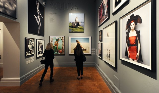 "Journalists attend the press preview for ""Vogue 100: A Century of Style"" exhibiting the photographs that has been commissioned by British Vogue since it was founded in 1916 at National Portrait Gallery on February 10, 2016 in London, England. (Photo by Stuart C. Wilson/Getty Images)"