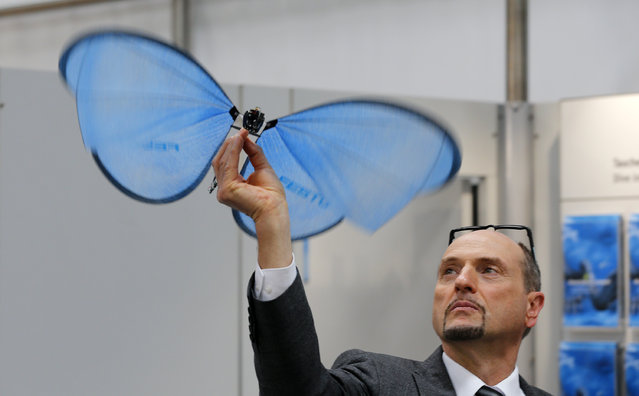 An employee presents the eMotion Butterfly, a collision-free flying object, developed by German FESTO company, at the world's largest industrial technology fair, the Hannover Messe, in Hanover April 12, 2015. (Photo by Wolfgang Rattay/Reuters)