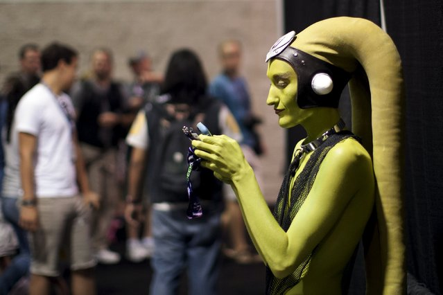 A woman in costume checks her phone at the Star Wars Celebration convention in Anaheim, California, April 16, 2015. The Star Wars Celebration runs through April 19 at the Anaheim Convention Center. (Photo by David McNew/Reuters)