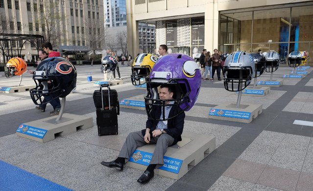 Oversized NFL football helmets are displayed in Pioneer Court Wednesday, April 15, 2015, in downtown Chicago, as the city prepares to host the NFL draft from April 30 to May 2. (Photo by Kiichiro Sato/AP Photo)