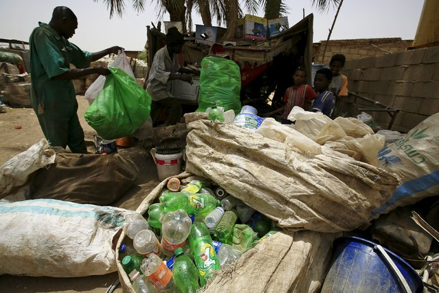 A man brings plastic materials to a recycling station in Khartoum North April 16, 2015. (Photo by Mohamed Nureldin Abdallah/Reuters)