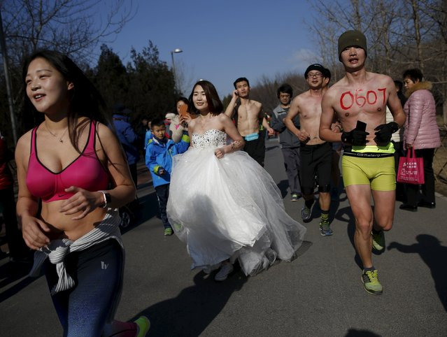 "Participants run at the ""Half-Naked Marathon"" at Olympic Forest park in Beijing, China, February 28, 2016 (Photo by Kim Kyung-Hoon/Reuters)"