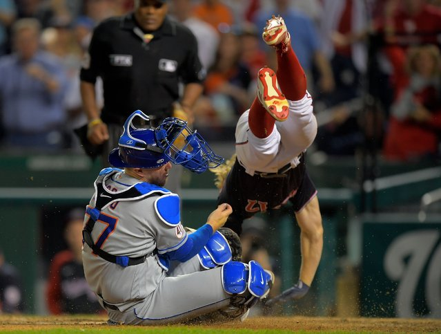 Washington Nationals fielder Andrew Stevenson (17), right is safe at home after colliding with New York Mets catcher Chance Sisco (77) to tie the score at 2 in the bottom of the 9th inning to send the game into extra innings during a  game between the Washington Washington Nationals and theNew York Mets at Nationals Park in Washington, DC on September  3, 2021. (Photo by John McDonnell/The Washington Post)