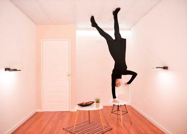 """A visitor poses for a picture in the """"Rotated Room"""" of the Museum of Illusions in Pristina on February 26, 2019. The museum contains a series of optical illusions giving the visitor the chance to produce unusual 3D images of themselves. (Photo by Armend Nimani/AFP Photo)"""