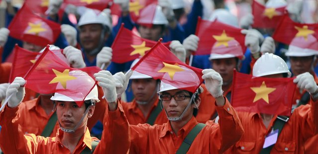 Vietnamese workers march during a rehearsal for a military parade as part of the 40th anniversary of the fall of Saigon in southern Ho Chi Minh City (formerly Saigon City), Vietnam, on April 26, 2015. (Photo by Reuters/Kham)