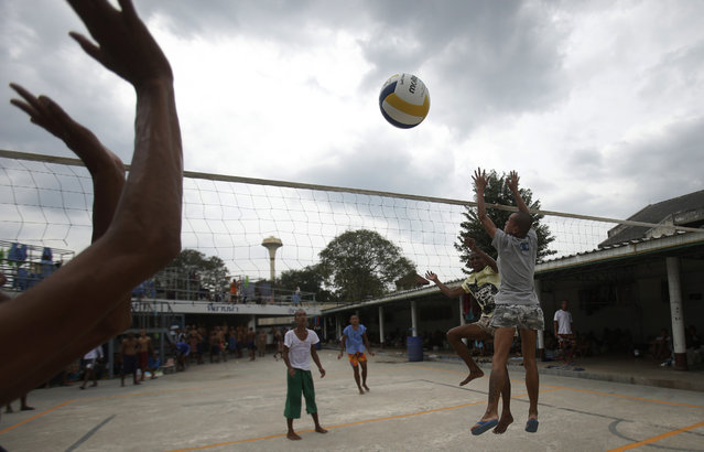 In this January 6, 2017 photo, transgender inmates play volleyball at Pattaya Remand Prison in Pattaya, Chonburi province, Thailand. (Photo by Sakchai Lalit/AP Photo)