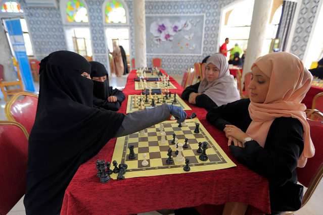Women take part in a local Chess championship in Yemen's capital Sanaa on August 25, 2021. (Photo by Mohammed Huwais/AFP Photo)