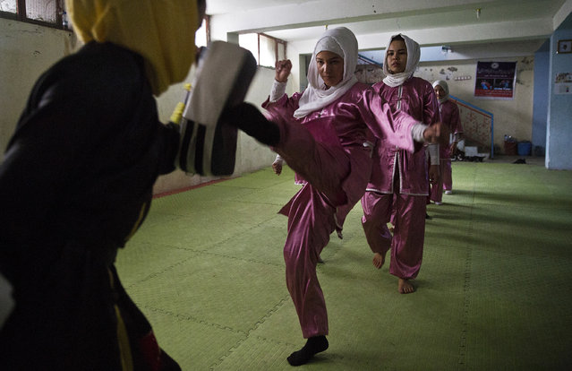 Shaolin martial arts students practice at their club in Kabul, Afghanistan, Tuesday, January 25, 2017. They are preparing for the day that Afghanistan can send its women's team to the Shaolin world championship in China. (Photo by Massoud Hossaini/AP Photos)
