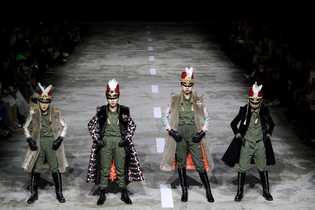 Models present creations by designer Hu Sheguang at China Fashion Week in Beijing, China, March 25, 2019. (Photo by Jason Lee/Reuters)