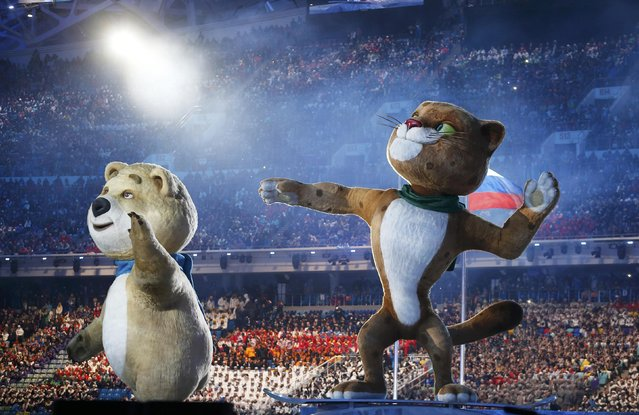 The mascots of the 2014 Sochi Winter Olympics, a bear and a leopard, take part in the opening ceremony of the 2014 Sochi Winter Olympics, February 7, 2014. (Photo by Jim Young/Reuters)