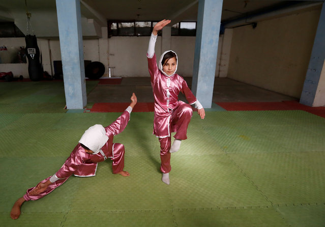 Mena Azimi (R), 15, practices at the Shaolin Wushu club in Kabul, Afghanistan January 19, 2017. (Photo by Mohammad Ismail/Reuters)