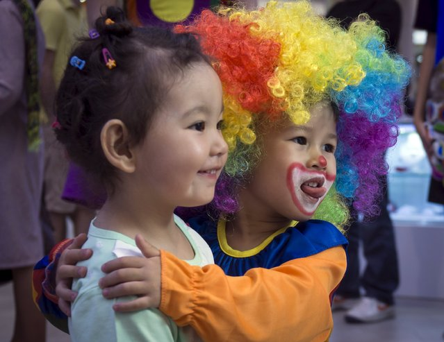 Children play during the Day of Clown festival in Almaty, Kazakhstan, April 24, 2015. (Photo by Shamil Zhumatov/Reuters)