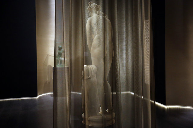 A marble statue of ancient Greek goddess Aphrodite is displayed for the first time in the National Archaeological Museum in Athens, Greece, 04 April 2019. The sculpture, which used to be a part of Iolas collection and belongs to the statues of the so called Capitolian type, is a work of the Roman times with numerous ancient and modern restorations. It follows a Hellenistic version of the Aphrodite of Praxiteles, assigned to his son, Cephisodotos, and dated around 300 BC. (Photo by Orestis Panagiotou/EPA/EFE)
