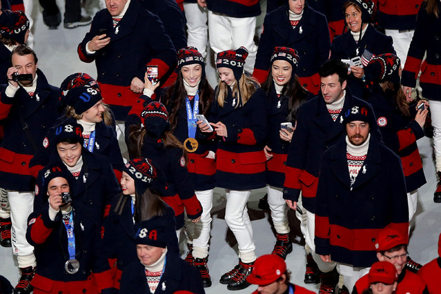 U.S. Olympians enter the Fisht Stadium as part of the 2014 Sochi Winter Olympics Closing Ceremony at Fisht Olympic Stadium on February 23, 2014 in Sochi, Russia.  (Photo by Joe Scarnici/Getty Images)
