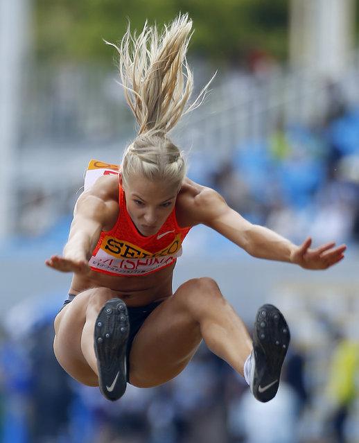 Darya Klishina of Russia competes in the women's long jump at of the Golden Grand Prix track and field in Kawasaki, near Tokyo, Sunday, May 10, 2015. (Photo by Shizuo Kambayashi/AP Photo)
