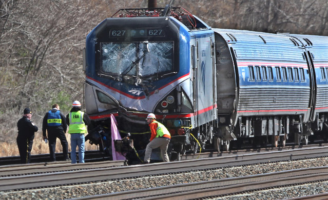 Amtrak investigators inspect the deadly train crash in Chester, Pa., Sunday, April 3 2016. The Amtrak train struck a piece of construction equipment just south of Philadelphia causing a derailment. (Photo by Michael Bryant/The Philadelphia Inquirer via AP Photo)