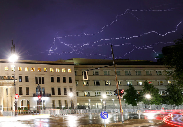 Thunderbolts are seen over the U.S. Embassy in Berlin, Germany, August 9, 2018. (Photo by Fabrizio Bensch/Reuters)