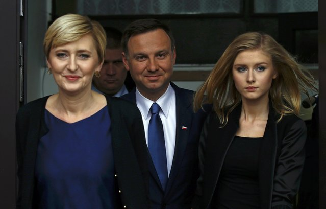 Presidential candidate of the Law and Justice Party Andrzej Duda (C) leaves a polling station with his wife Agata and daughter Kinga in Krakow, Poland May 24, 2015. Poles vote for a president on Sunday in a run-off that is too close to call but already spells trouble for the ruling Civic Platform as it looks to re-election later in the year. (Photo by Kacper Pempel/Reuters)