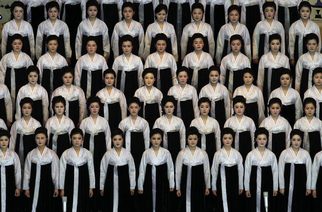 North Korean performers pause before singing at the Pyongyang indoor gymnasium to commemorate late president Kim Il Sung's 100th birthday in Pyongyang, North Korea, Monday, April 16, 2012. (Photo by Vincent Yu/AP Photo)