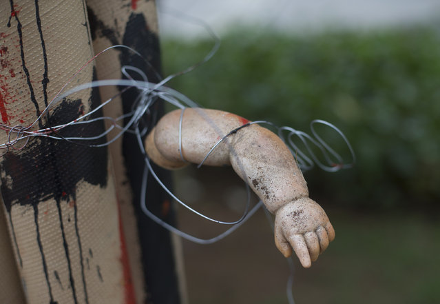 The arm of a doll is part of a sculpture made from trash, on display at the Rio de Janeiro Federal University at an exhibit titled The Sea Isnt Made for Fish in Rio de Janeiro, Brazil, Monday, June 1, 2015. Art students have taken advantage of a material they have in endless supply trash to create an exhibition that aims to draw attention to the fetid state of the citys Guanabara Bay, where the Olympic sailing events are to be held next year. (AP Photo/Silvia Izquierdo)