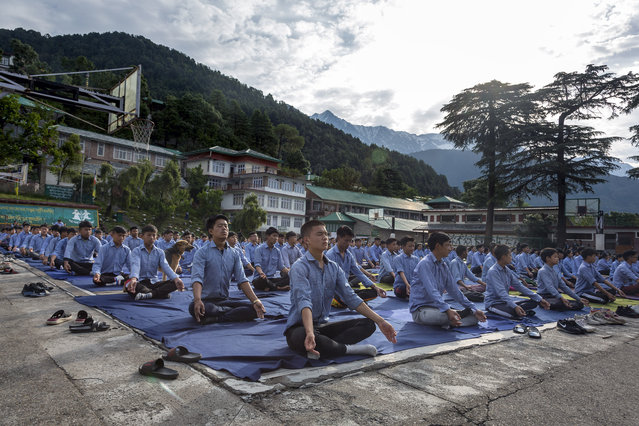 Exile Tibetan students of Tibetan Children's Village School participate in a yoga session to mark International Yoga Day in Dharmsala, India, Friday, June 21, 2019. (Photo by Ashwini Bhatia/AP Photo)