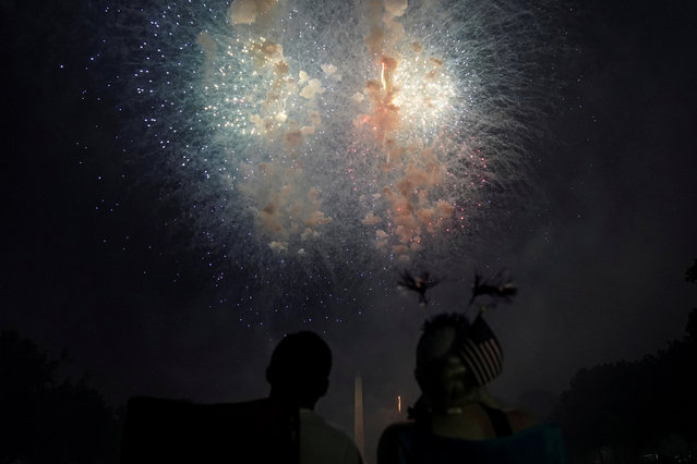 People watch fireworks during the 4th of July Independence Day celebrations at the National Mall in Washington, U.S., July 4, 2018. (Photo by Toya Sarno Jordan/Reuters)