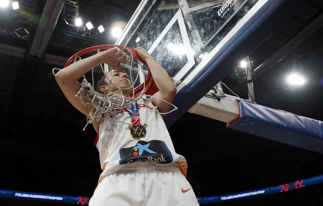 Spain's Silvia Dominguez cuts down the net after the Women's 2019 Eurobasket European Basketball Championship final match between Spain and France in Belgrade, Serbia, Sunday, July 7, 2019. (Photo by Darko Vojinovic/AP Photo)