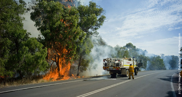 Fire fighters battle a breakout after a bush fire swept through the area in Margaret River, Australia