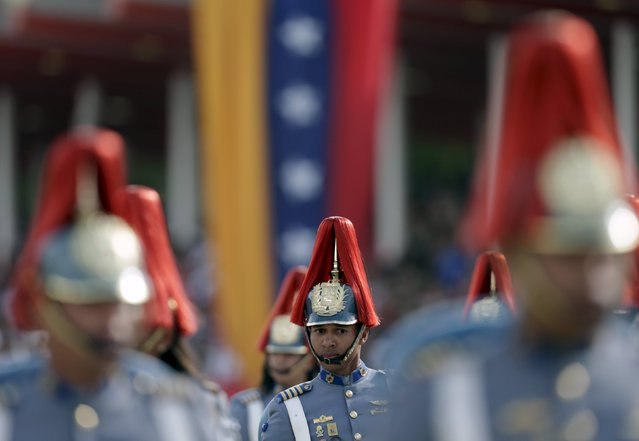 Venezuelan soldiers march during a military parade to celebrate the anniversary of Venezuela's independence in Caracas, July 5, 2015. (Photo by Jorge Dan Lopez/Reuters)