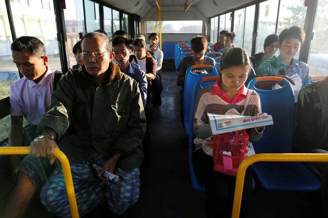 People ride a bus as they travel in Yangon, Myanmar January 16, 2017. (Photo by Soe Zeya Tun/Reuters)