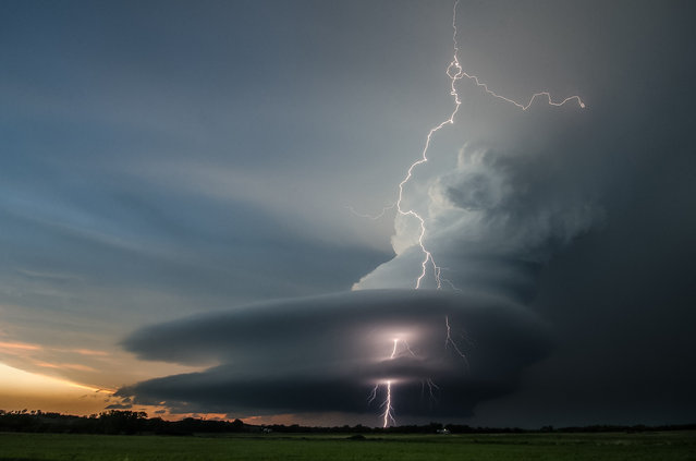 """Strike Through The Mothership"". Every May for the last 3 years I have driven down to Tornado Alley to capture some amazing storms. This supercell held so much promise to drop a tornado but one small shift in the atmosphere and all that it produced was an extreme lightning show. Photo location: Broken Bow, Nebraska. (Photo and caption by Vanessa Neufeld/National Geographic Photo Contest)"