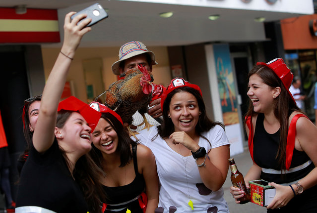 "People take a picture with ""Paquito"" in San Jose, Costa Rica April 27, 2017. (Photo by Juan Carlos Ulate/Reuters)"