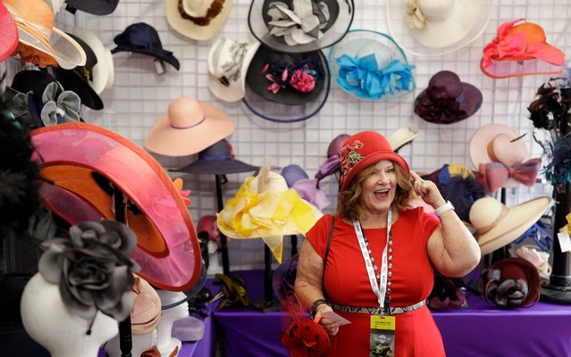 Cher Green-Hawt tries on a hat at the Breeders' Cup horse races at Santa Anita Park, Saturday, Nov. 2, 2019, in Arcadia, Calif. (Photo by Gregory Bull/AP Photo)