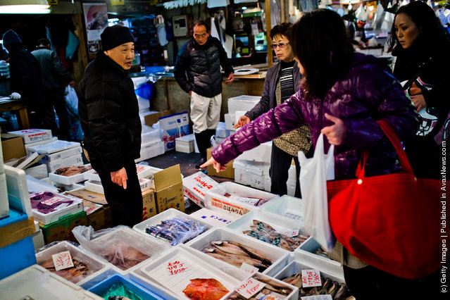 Customers point to a fish they would like to purchase at the Tsukiji fish market