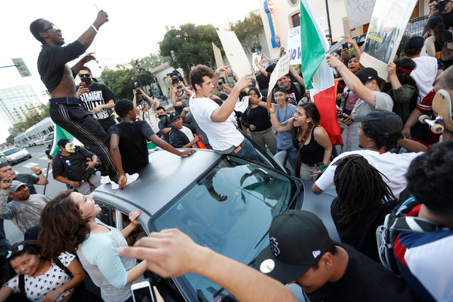 Demonstrators chant around a car during a demonstration against Republican U.S. presidential candidate Donald Trump after his campaign rally in San Jose, California, U.S. June 2, 2016. (Photo by Stephen Lam/Reuters)