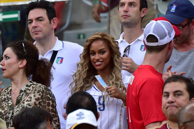 Fanny Neguesha, fiancee of Italy's forward Mario Balotelli is seen in the stadium during a Group D football match between England and Italy at the Amazonia Arena in Manaus during the 2014 FIFA World Cup on June 14, 2014. (Photo by Giuseppe Cacace/AFP Photo)