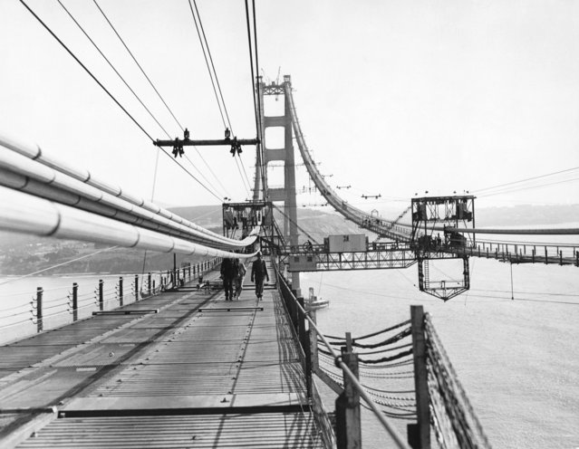 Construction of the Golden Gate Bridge with a view of the catwalks being placed under the cables, 1936. (Photo by Underwood Archives/Getty Images)