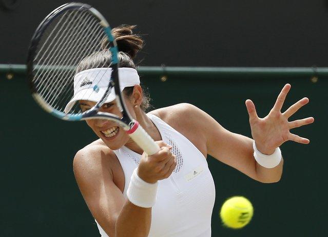 Spain's Garbine Muguruza returns to Romania's Sorana Cirstea during their Women's Singles Match on day six at the Wimbledon Tennis Championships in London Saturday, July 8, 2017. (Photo by Kirsty Wigglesworth/AP Photo)