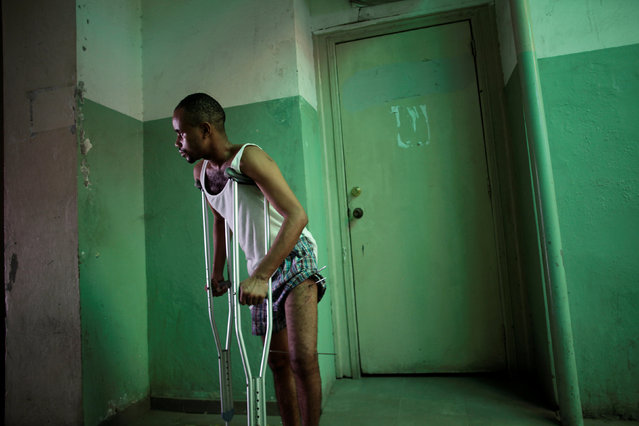 A patient walks in a corridor in the Hospital of the State University of Haiti, which is one of the centers affected by a three-month-long strike by health workers demanding a pay rise and resources, in Port-au-Prince, Haiti, June 20, 2016. Picture taken June 20, 2016. (Photo by Andres Martinez Casares/Reuters)