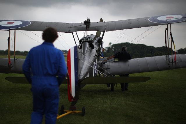"""The SE5a is taken to position for demonstration flight at """"The Shuttlesworth Collection"""" at Old Warden on July 21, 2014 in Biggleswade, England. Of the 55,000 planes that were manufactured by the Royal Army Corps (RAC) during WWI, only around 20 remain in airworthy condition. (Photo by Dan Kitwood/Getty Images)"""