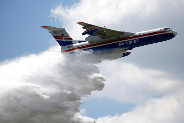A Beriev Be-200ES firefighting airplane releases water during a flying display during the 53rd International Paris Air Show at Le Bourget Airport near Paris, France, June 17 2019. (Photo by Pascal Rossignol/Reuters)