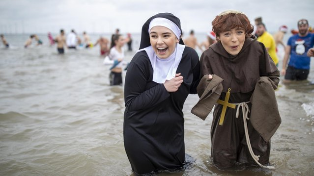 Bathers brave the cold waters of the North Sea as they take part in the annual Boxing Day dip at Redcar Beach on December 26, 2019 in Redcar, England. The event attracts hundreds of people each year who take to the cold water wearing fancy dress as they help to raise money for a number of charities. (Photo by James Glossop/The Times)