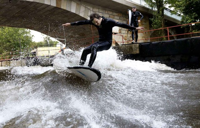 Jan Marsik enjoys an artificial wave built on Elbe river's channel in Brandys nad Labem, Czech Republic, Tuesday, August 5, 2014. The recently opened wave serves as the only surf spot in the landlocked Czech Republic. (Photo by Petr David Josek/AP Photo)