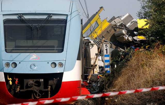 Wreckage is seen at the site where two passenger trains collided in the middle of an olive grove in the southern village of Corato, near Bari, Italy, July 12, 2016. (Photo by Alessandro Garofalo/Reuters)