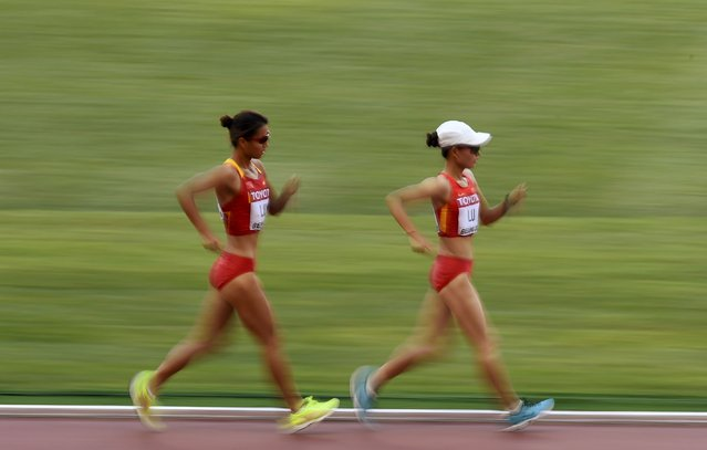 Liu Hong of China (L) and Lu Xiuzhi of China compete in the women's 20 km race walk final during the 15th IAAF World Championships at the National Stadium in Beijing, China August 28, 2015. (Photo by Dylan Martinez/Reuters)