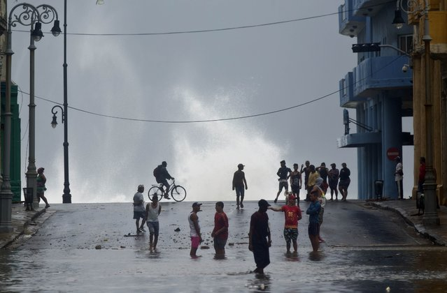 Residents watch the ocean waves crash into the water front, after the passage of Hurricane Irma, in Cuba, Sunday, September 10, 2017. (Photo by Ramon Espinosa/AP Photo)