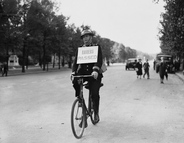 A policeman cycles through London's streets with the raiders passed notice, on September 3, 1939, after the first raid warning of the war. (Photo by AP Photo)