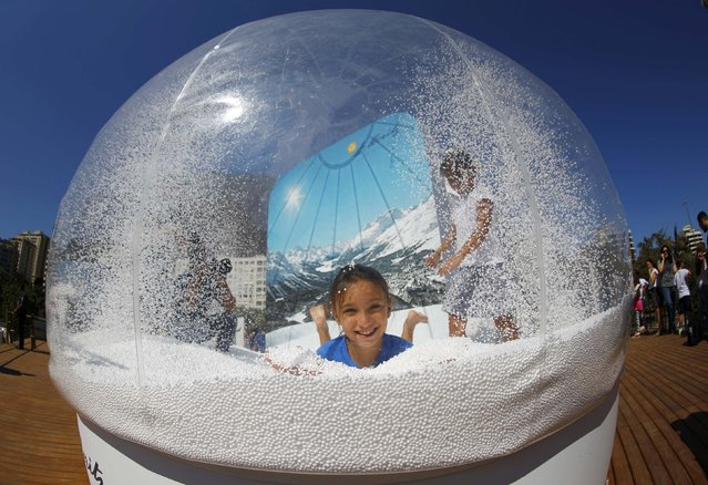 A girl plays in a display at the Switzerland house in Lagoa, Rio de Janeiro, Brazil on August 1, 2016. (Photo by Ivan Alvarado/Reuters)