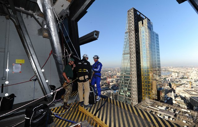 Rupert Atkin, CEO of Talbot Underwriting, abseils down the Gherkin during the Outward Bound Trust's and the Royal Navy & Royal Marine's Charity's most daring stunt: The City Three Peaks Challenge on September 7, 2015 in London, England. (Photo by Stuart C. Wilson/Getty Images for the Outward Bound Trust and the Royal Navy and Royal Marines Charity)