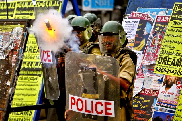 Police fire tear gas at students to prevent them from marching towards the Andhra Pradesh state legislative assembly at Osmania University in Hyderabad, India, on September 17, 2012. The students demanded that a new state of Telangana be carved from the existing Andhra Pradesh state. (Photo by Mahesh A. Kumar/Associated Press)
